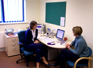 Photograph of a doctor with their patient in a consulting room
